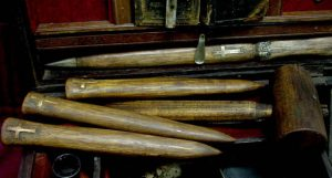1809 Vampire Killing Kit - close up of 3 wooden stakes and maul
